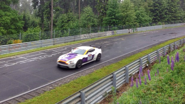 A photo of an Aston Martin race car practicing on The Nurburgring during one of our Nurburgring tours.
