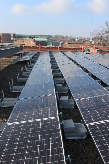 First rooftop solar installation in downtown Aurora. 2018 will be a Happy New Year!