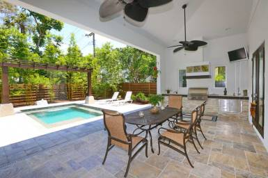 Upscale Pool Design with Waterfall by Covered Lanai