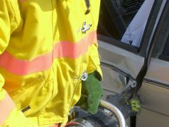Firefighter Using Jaws of Life on a Car Involved in an Accident