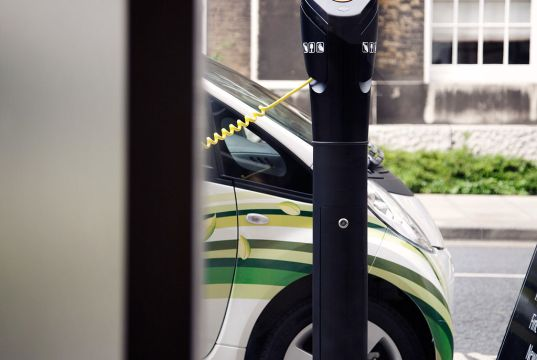 Electric Vehicle Parked at a Charging Station