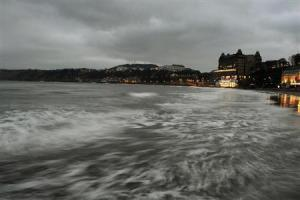 The tide comes in as the sun sets on the seafront in Scarborough