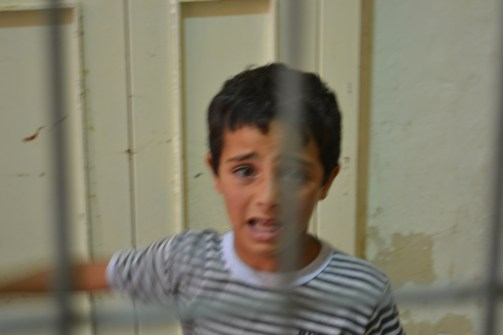 Distressed child at a Hebron checkpoint (David Kattenburg)