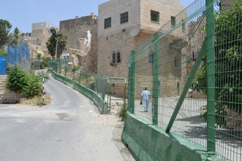 The Great Divide. Separation barrier leading from Ibrahimi mosque checkpoint. (David Kattenburg)
