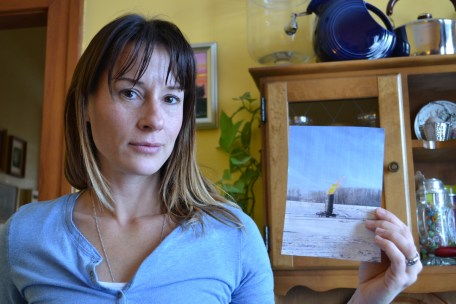 "Diana Daunheimer and her photo of an exposed ""incinerator"" flame"