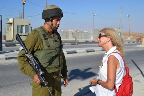 Israeli human rights activist speaks with an Israeli soldier.