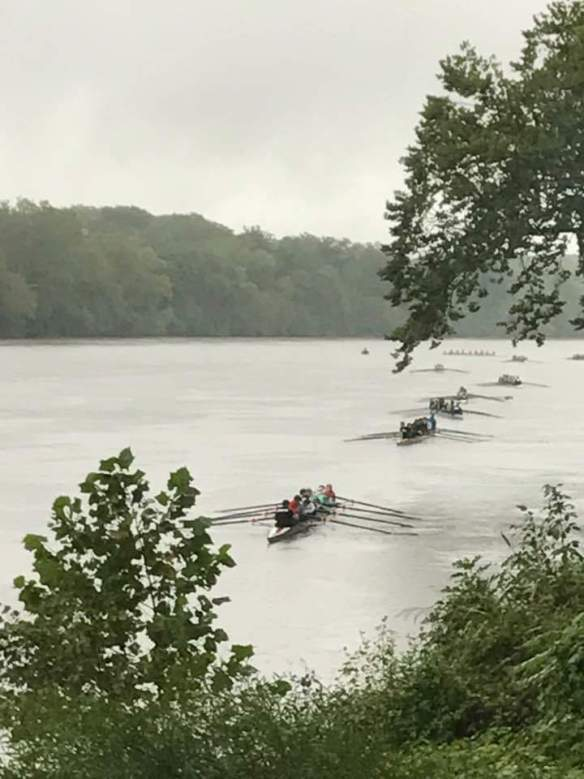 Crews line the James River after racing as they return to the dock.