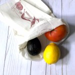 Image of produce bag with avocado, lemon and tomato. 3 Tips For Your First Zero-Waste Shopping Trip
