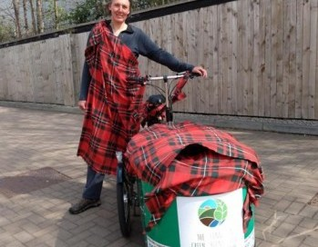 Margon beside her cargo bike dressed in tartan