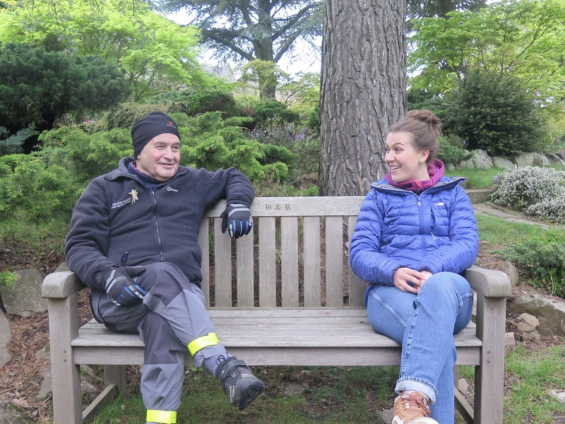 Peter and Iona sitting on a park bench