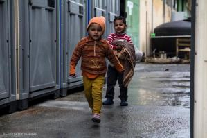 Two boys playing on a rainy afternoon. Photography by Abdulazez Dukhan, Through Refugee Eyes