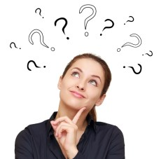 Thinking smiling woman with questions mark above head looking up