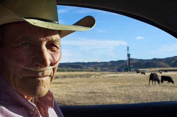 Gary Packard drives past a newly constructed oil well that sits at the edge of his ranch. (Photo: Ed Glazar)