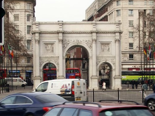 Marble Arch Surrounded by Traffic Photo by Txllxt TxllxT