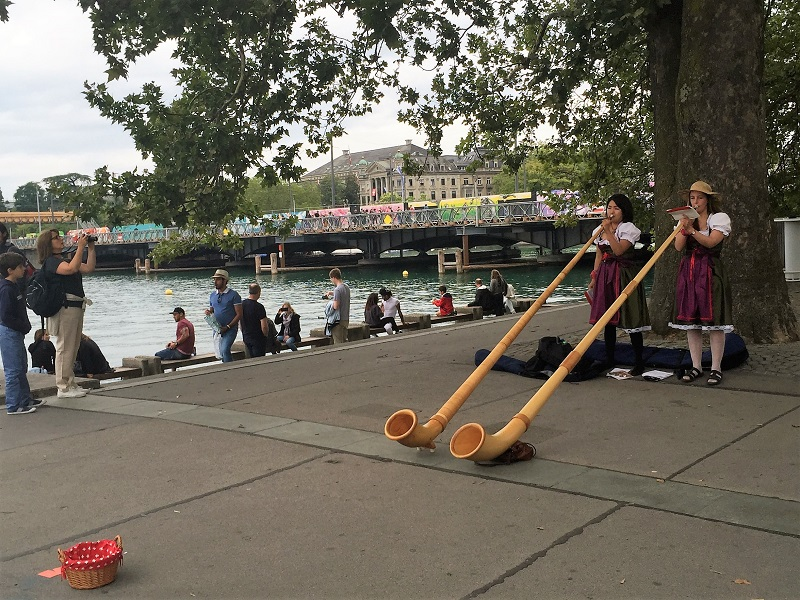 Traditional Swiss horn blowing at Lake Zurich