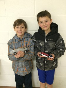 Grayson & Crew with their Pinewood Derby cars.