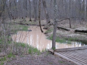 Polluted stream flowing into the St. Croix River from a frac sand mine