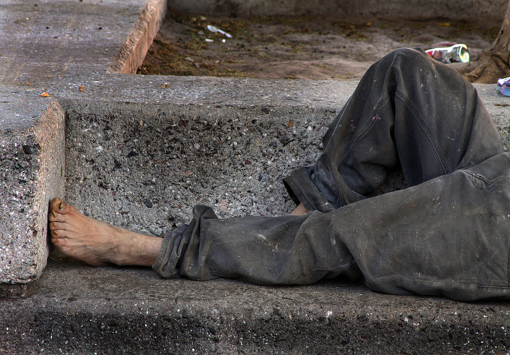 """Homeless on Bench,"" by Tomas Castelazo; CC BY-SA 3.0; GFDL, via Wikimedia Commons"