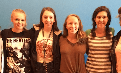 Jess Sweeney, executive directory of the ROOTS Teen Center, with members of the MCLA LEAD Academy, who helped get the center ready for operations.