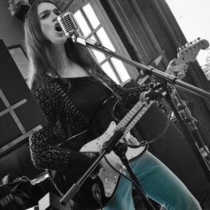 Catrin Lloyd-Bollard performs as CATFOX at the Castle Hotel, Aberystwyth, Wales; photo by Craig Kirkwood.