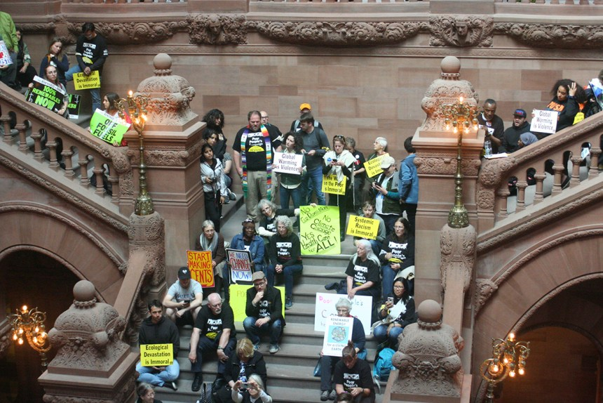 "Demonstrators occupy the ""Million Dollar Stairway"" in the Capitol Building in Albany, New York June 4, 2018; photo by Jason Velázquez."