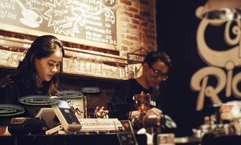 Workers at a counter in a cafe; photo by Afta Putta Gunawan