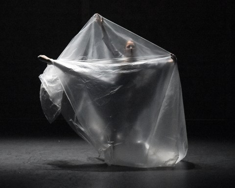 Photo of dancer dancing in large clear plastic bag:The Happiness Project runs through July 21, at Jacob's Pillow; photo by Grace Kathryn Landefeld.