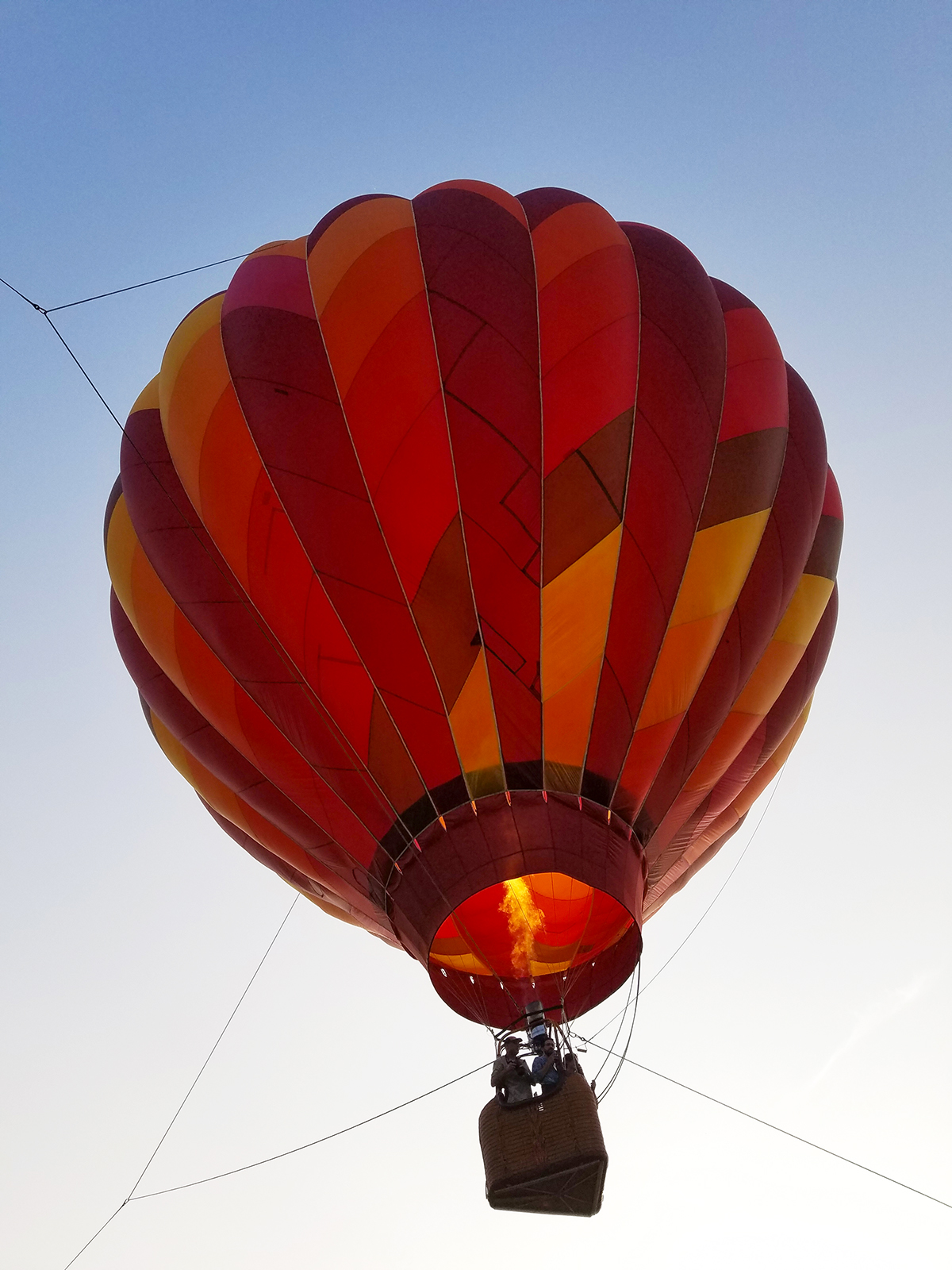 Image of Hot Air Balloon. Caption: Ever wonder what a hot air balloon ride feels like? Why not treat yourself to a tethered launch? You might get hooked on the feeling! Photo by Robin Catalano.