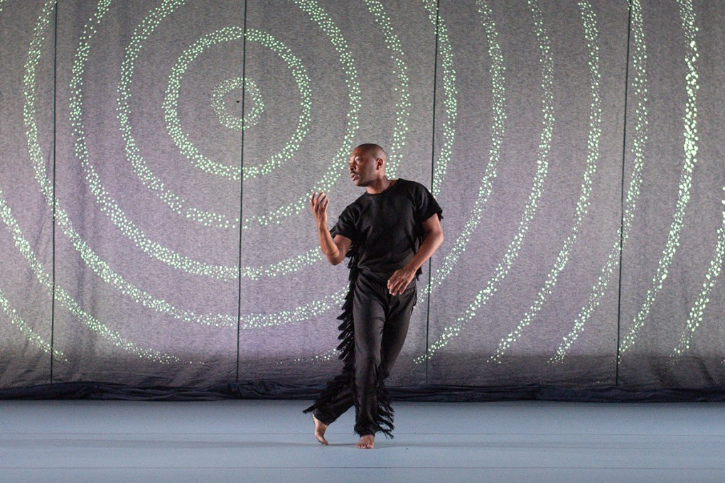 """Photo of solitary male dancer on stage: Kyle Abraham of A.I.M in """"INDY""""; photo Grace Kathryn Landefeld"""