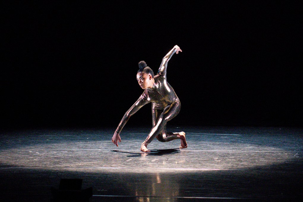 """Photo of solitary female dancer on stage in a pool of light: Marcella Lewis of A.I.M in """"Show Pony""""; photo Grace Kathryn Landefeld"""