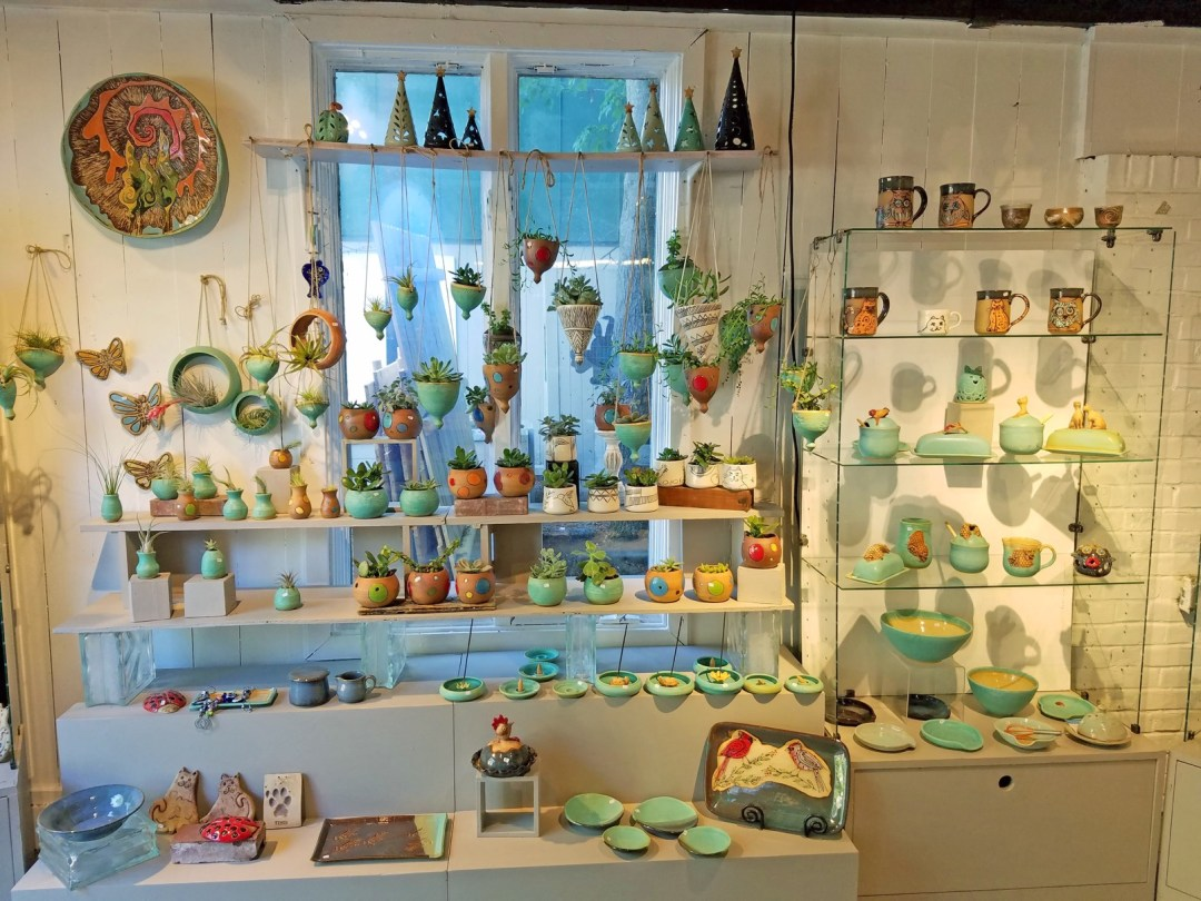 Independent artists create and sell their wares on Artists' Row, where you can pick up original art and handcrafts at affordable prices; photo By Robin Catalano.