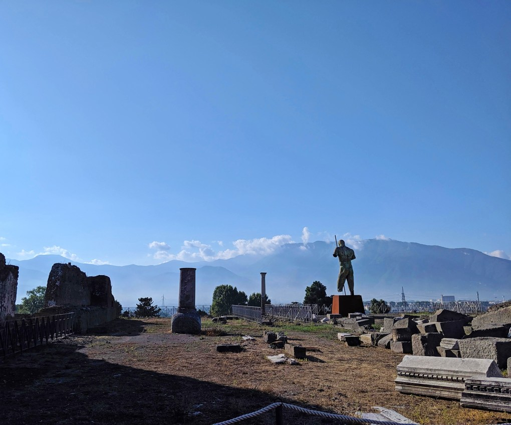 There are fragments of statuary, columns, walls, and doors nearly everywhere in Pompeii. The bronze statue of a man at right is Daedalus, the work of Polish artist Igor Mitoraj, who, just before he died in 2014, helped organize an exhibit of his monumental works. The sculpture was later donated permanently to Pompeii, where it sits just outside the Temple of Venus.
