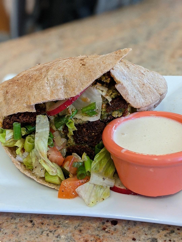 Photo of a felafel pita sandwich.