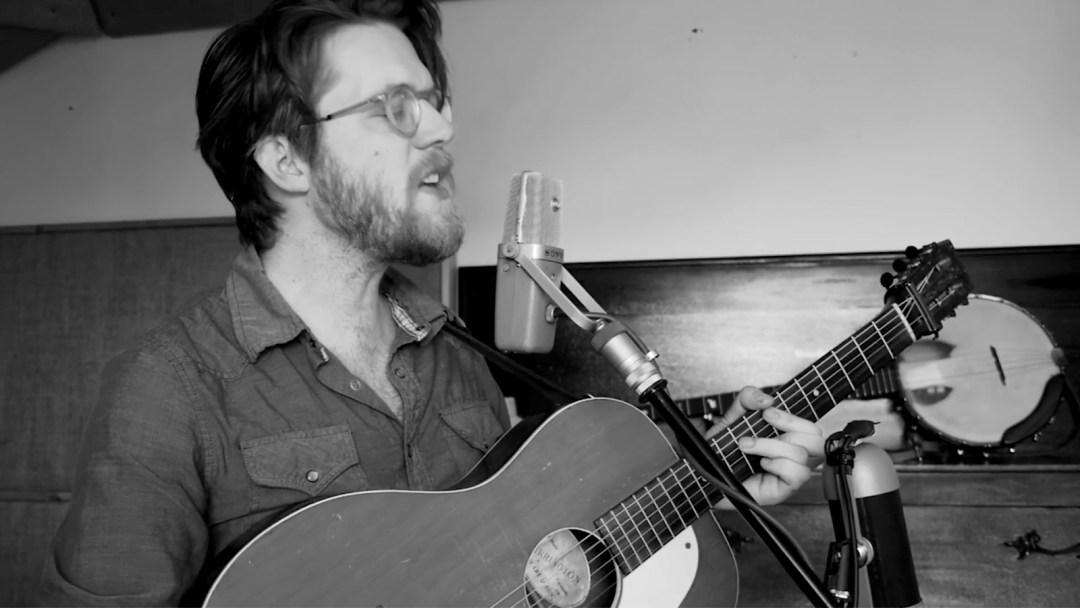 Ashton Taylor, playing guitar