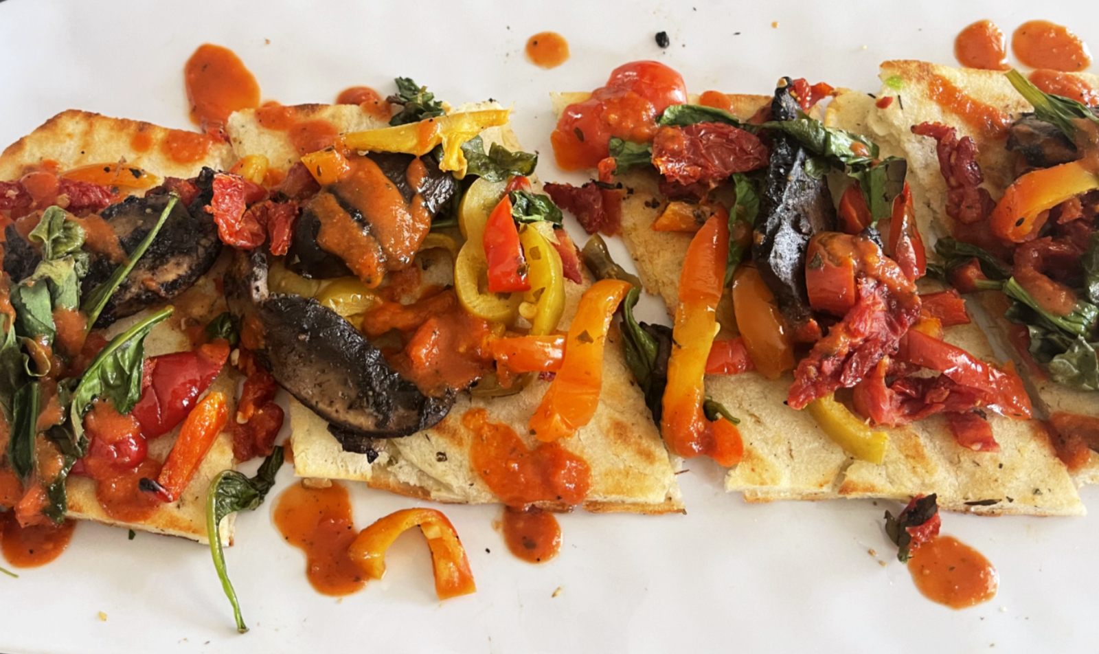 photo of flatbread with mixed peppers and mushrooms