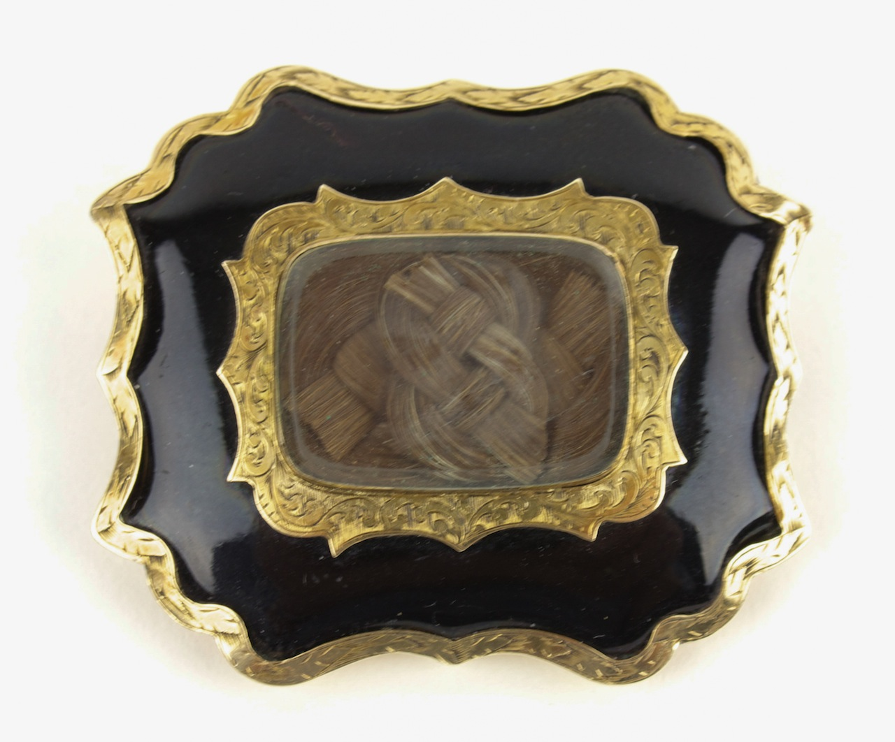 """Maker unknown, """"Mourning Brooch in Memory of Stephen Gore with a Lock of his Hair and the Inscription on the Verso, 'Stephen Gore/Born/Apl 29th 1790/Obt/Sept 16 1845′"""" (c. 1845), gold, steel clasp, glass and hair, Collection of Janet Hasson"""