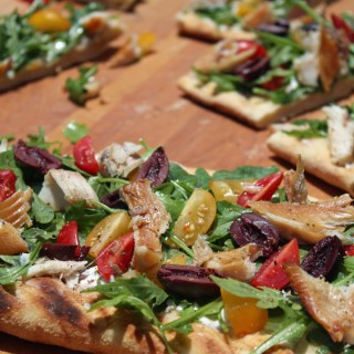 Flavorful Grilled Flatbread with Smoked Trout, Goat Cheese and Arugula