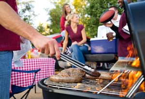 Brats on the Grill at a Tailgate Party