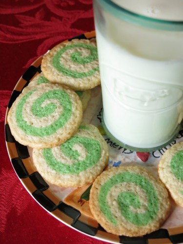 Vegan holiday decorated with a spiral pattern nutmeg cookies are the perfect holiday treat. Go great with milk for santa or really anything!