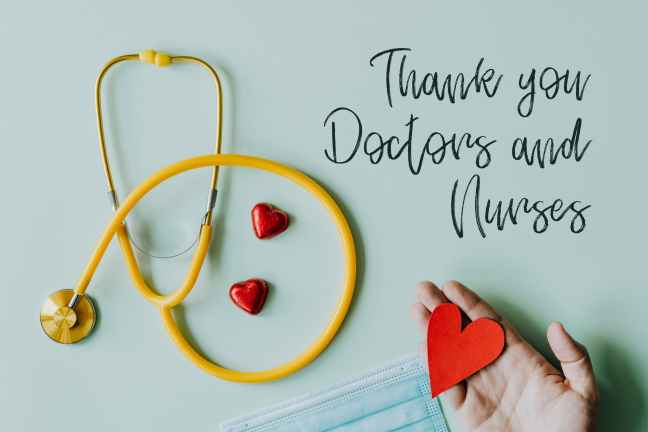 crop hand with red paper heart on white background with stethoscope and mask