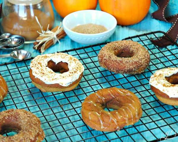 Purely Pumpkin Baked Donuts | How sweet it is to bake healthy, gluten free, and homemade donuts with all the flavors of fall! This cute seasonal breakfast recipe is packed with flavor, yet low in calories (no refined sugar). The best part about these skinny baked treats is that you can choose your favorite of 3 toppings recipes (coconut butter, greek yogurt, cinnamon)! These are the best option for anyone choosing an easy clean eating or whole foods lifestyle!