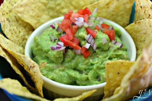 "My ""Best Guacamole Dip EVER"" is surprisingly easy to make and super healthy! I am always asked to bring this simple and creamy recipe to parties- it is famous! I prefer this homemade recipe a little chunky and a little spicy- that's where the Frank's Hot Sauce comes in. You can eat this avocado dip with tortilla chips or veggies, on a salad, or right off the spoon! It is the perfect appetizer to bring for Super Bowl or Cinco de Mayo!"