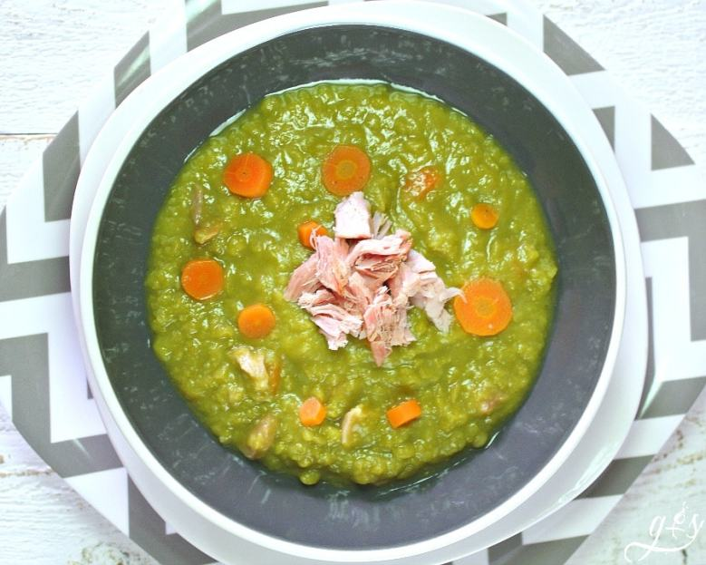 Simply the BEST Split Pea Soup- an easy and healthy stove top meal recipe that uses leftover ham or turkey bacon along with tons of clean eating vegetables and stock. Make it vegetarian or vegan by using vegetable broth and omitting the meat. This creamy, hearty, and classic homemade soup is simple to prepare and has been a family favorite of ours for years!