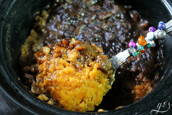 The BEST Skinny Sweet Potato Casserole - an easy, clean eating, & gluten free slow cooker side dish with a healthy candied pecan topping. This light recipe is perfect for Thanksgiving or any fall meal that needs a savory yet sweet make ahead crock pot dish. You can never go wrong with simple and classic recipes such as this one! The addition of eggs, coconut sugar, and butter make this Paleo-adaptable recipe the perfect fall comfort food!