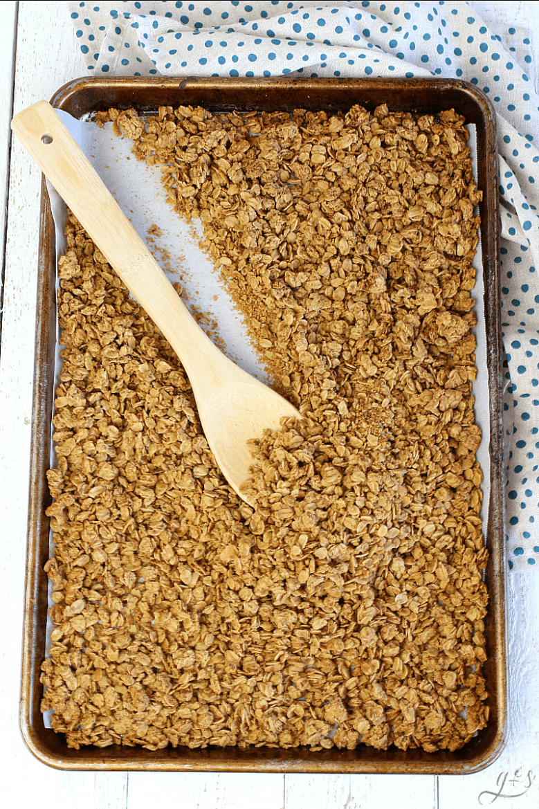 French Toast Granola | Homemade is always better right? It's usually more healthy! This gluten-free recipe has delicious clusters of almond pulp and oatmeal in a syrup-y caramel sauce that tastes just like your favorite breakfast. Use almond butter, vanilla, and maple extract to achieve this easy vegan snack. If you don't have almond pulp use coconut shreds or nuts.This clean eating and no sugar granola makes a great yogurt topper or eat it like cereal with milk! #vegan #glutenfree #cleaneating