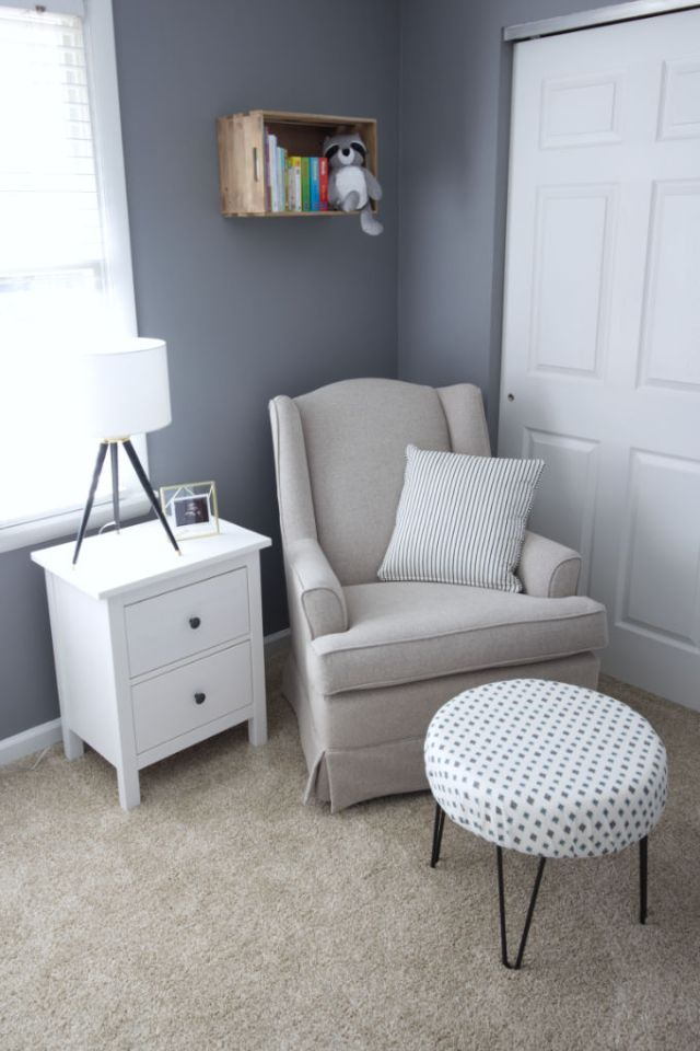 Baby nursery glider and book corner