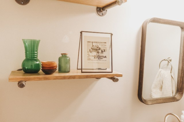 Half bathroom makeover shelving vintage industrial farmhouse decor plants modern vintage print on industrial shelf