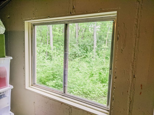 Old single pane egress basement window