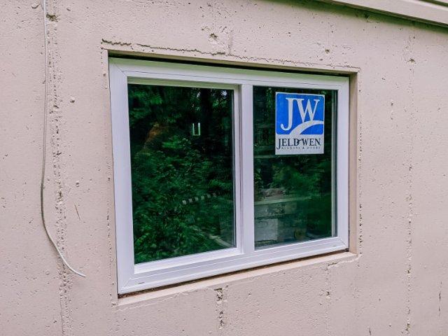 Double pane, energy efficient sliding egress basement window