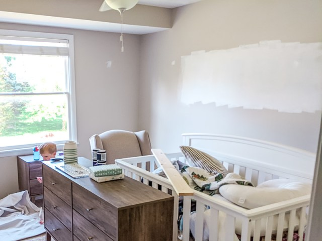 Primed over Behr paint swatches on wall in nursery